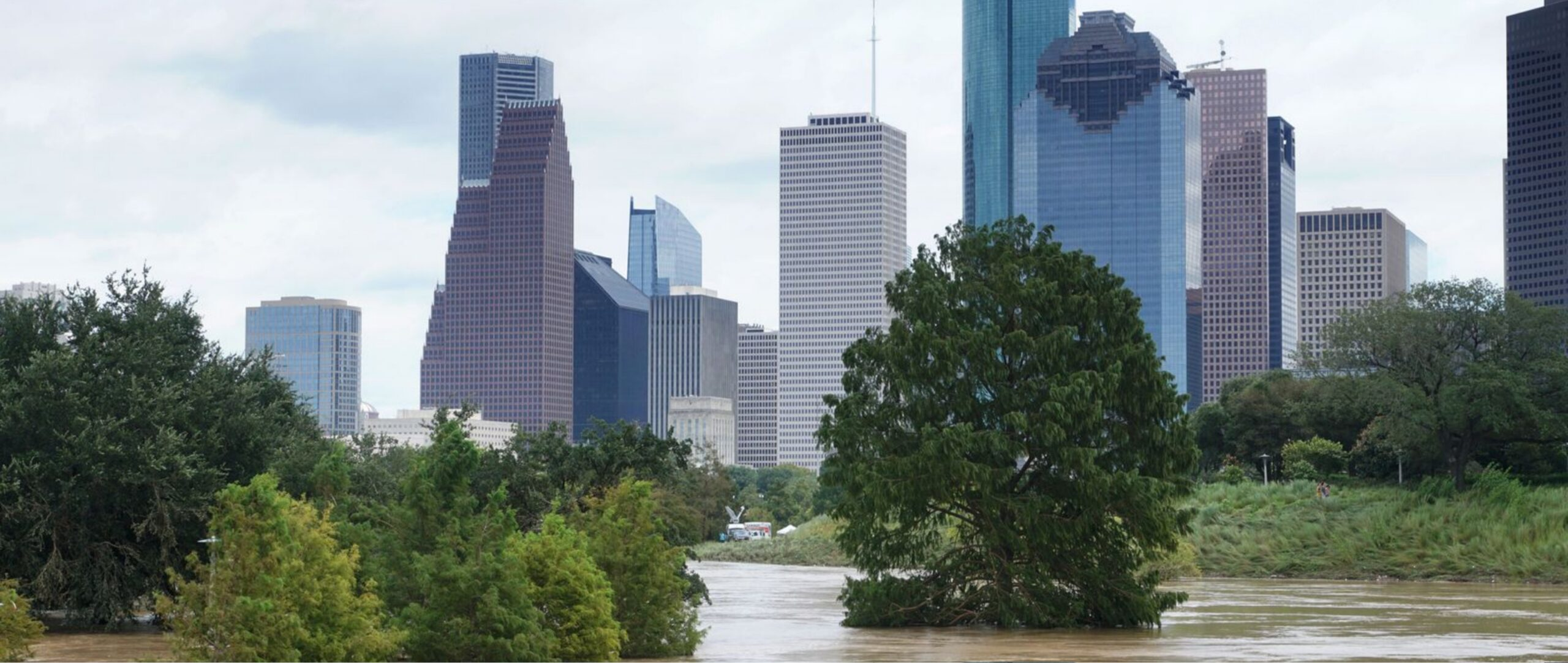 Flooded park in Houston from Hurricane Harvey with city skyline