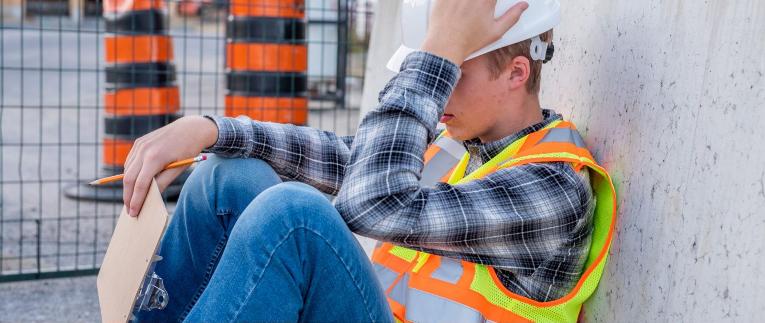Overwhelmed construction worker taking a break