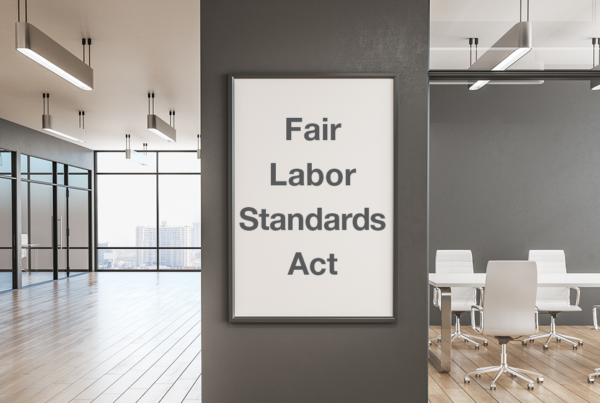 office space with a white poster on the wall with the words Fair Labor Standards Act written on it